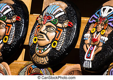 Souvenir masks from argentina, South America.