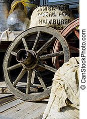 Vintage wagon wheel and old stuff in background - Retro