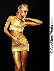 Glitter. Golden Woman over Black Background. Creative Contemporary Design