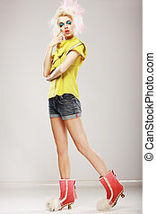 Stylishness. Ultramodern Fashion Model in Trendy Clothes. Individuality