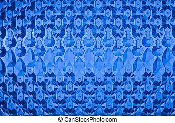 blue glass background - Glass elements are laid out on a...