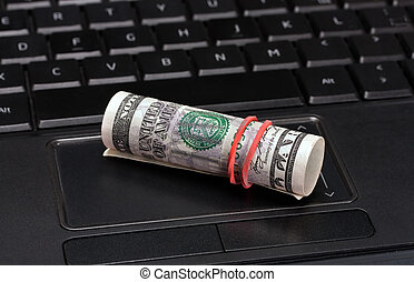 earnings in internet - business computer, conceptual image -...
