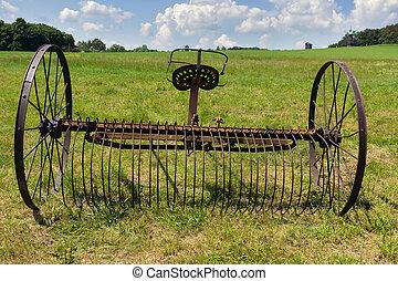 rusty harrow plow back - Old rusty harrow plow back near the...
