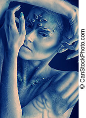 enigmatic - Art project: expressive young woman with...