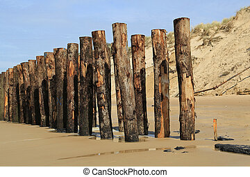 Wooden Wave Breaker - 05 - Wooden poles as wave breaker at...