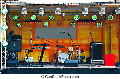 stage with music instruments - Lamps, amplifiers, and music...