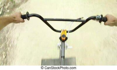 BMX biker jumping dirt jumps track.