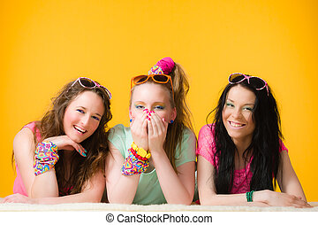 Having fun together - Three girls are having fun together,...