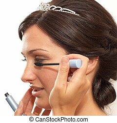 Wedding makeup - Young bride making her makeup for wedding...