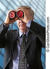 Money watcher - Businessman watching for new ways to develop...