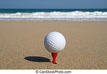 Golf ball on the beach, ready to be hit in to the ocean