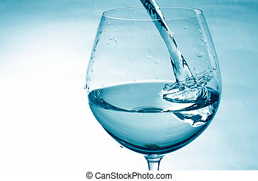 Pouring fresh water in blue