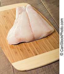 Fresh halibut steaks ready to cook - Fresh halibut steaks on...