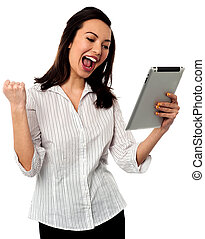 Excited businesswoman holding touch pad - Businesswoman with...