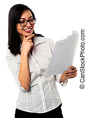 Female analyzing annual business reports - Successful young...