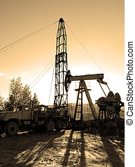 Oil Rig - Drilling for oil - mobile rig on top of the hill...