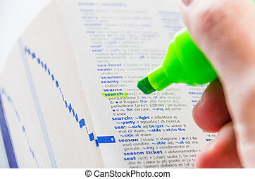 Highlighting the Search word on a dictionary - Close-up of a...