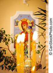 Candles in orthodox Church - Close up of lighting fire...