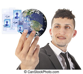Young man holding earth with social media symbols isolated...