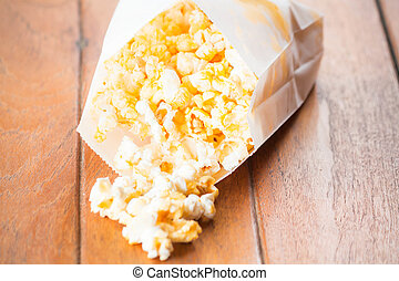 Popcorn pack opened with corn spilling out