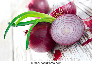Purple onion on wooden background