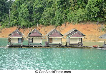 Boat house hotel floating in the dam