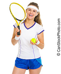 Portrait of smiling female tennis player with racket and...