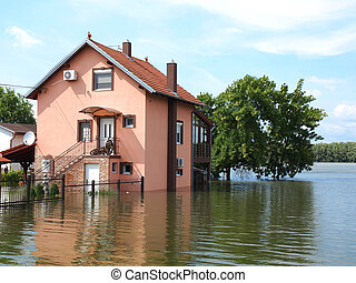 flooded house - big flooded house with blue sky and white...
