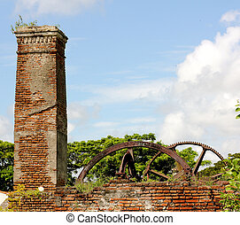 Brick and Metal Ruins - Ruins of an abandoned and overgrown...