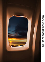 Plane Window - A sunset landscape from an airplane window.