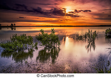 Benbrook Lake Sunrise - Vivid colors and reflections over...