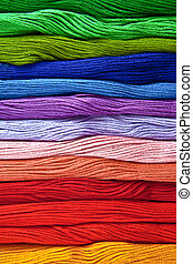 Colorful yarns in rainbow colors as a background