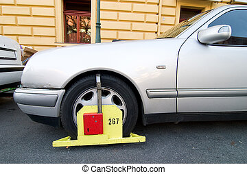 Parking Ticket Block - A wheel block parking ticket in...