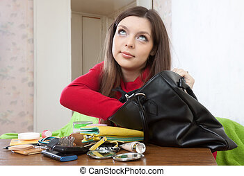 girl can not finding anything in her handbag - Pretty girl...