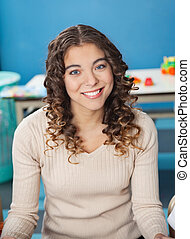 Beautiful Teacher With Smiling In Kindergarten - Portrait of...