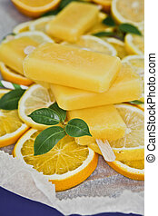 Orange popsicles on slices of fresh oranges
