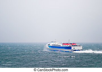 Speed Ferry on Ocean - A speed ferry catamaran on the Ocean