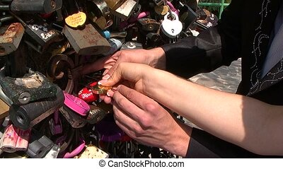 Wedding, lock - The bride and groom secure lock on happiness...