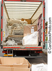 removals van or truck - plastic wrapped furniture loaded...