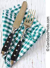 Cutlery - Rustic cutlery with green provence napkin on an...