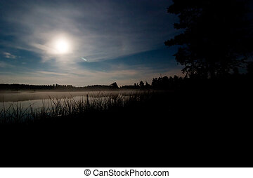 Moon over Lake - A landscape of a lake at night with the...