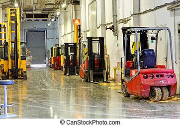 Forklift Trucks in stock. Corridor large warehouse. -...