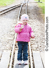 little girl at Ravenglass and Eskdale narrow gauge railway,...