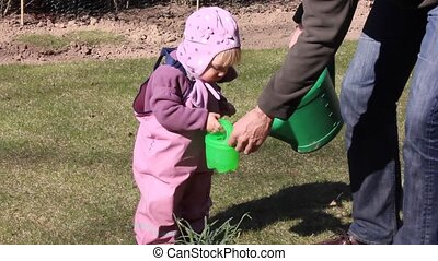 Watering the plants - Little girl one year and 5 months old...