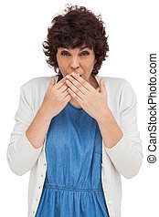 Surprised attractive woman placing hands on her mouth