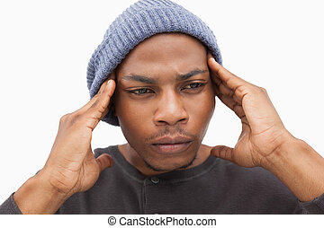 Worried man in beanie hat on white background