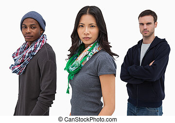 Serious stylish young people in a row on white background