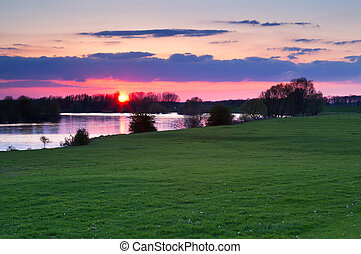 red sunset over Ijssel river, Gelderland, Netherlands