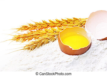 Spikelets of wheat with egg on flour spillage.Isolated. -...