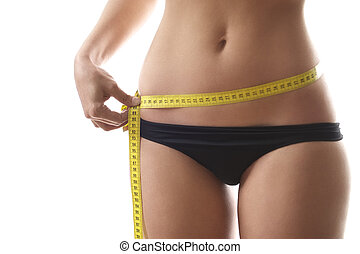 woman measuring waist with tape on white background - young...